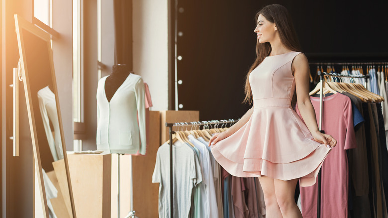 Woman trying on a pink dress