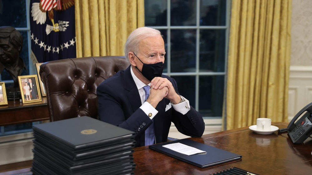 Joe Biden at the Resolute Desk in the Oval Office