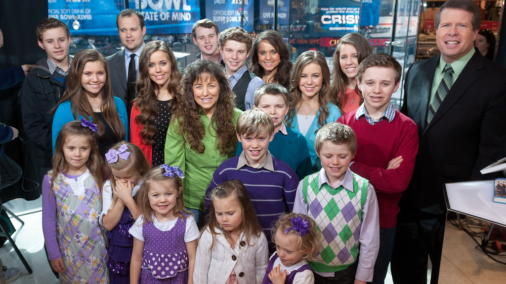 Duggar family photo on TV set