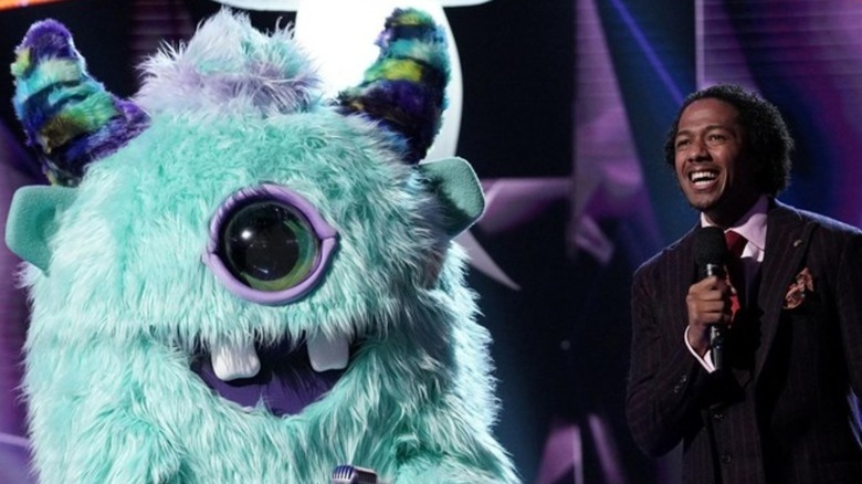 Nick Cannon with Masked Singer monster