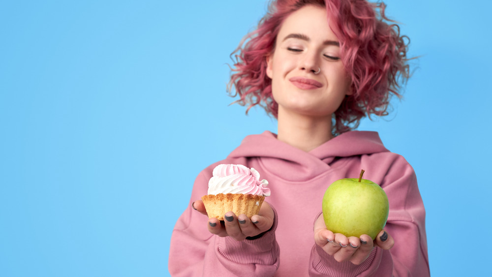 Woman with apple and cupcake