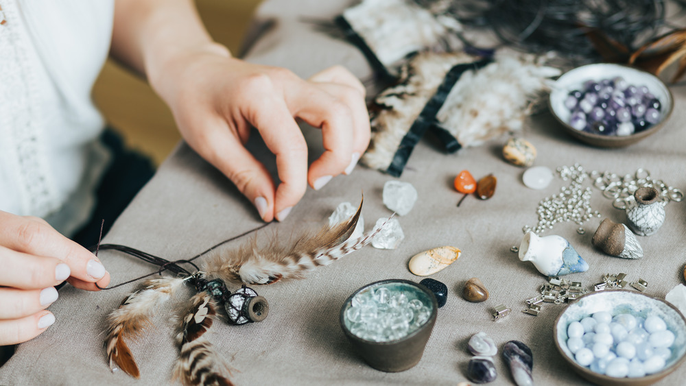 Woman making jewelry with crystals