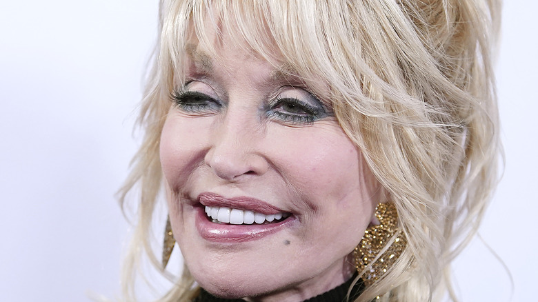 Dolly Parton smiles at an event