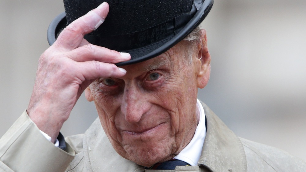 Prince Philip tipping his hat