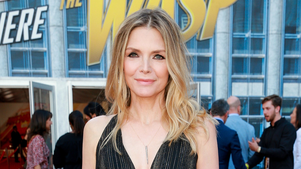 Actress Michelle Pfeiffer poses on red carpet