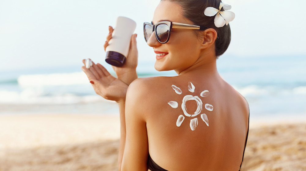 Woman with sunscreen on back