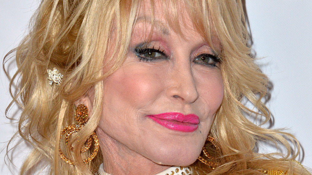 Dolly Parton pink lipsticked head tilted