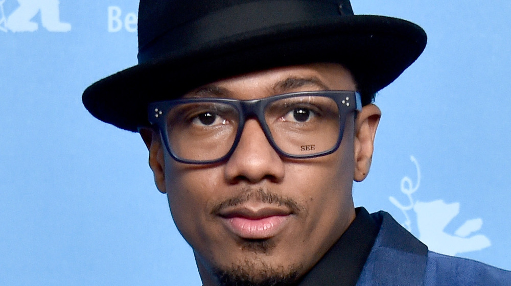 Nick Cannon wearing hat