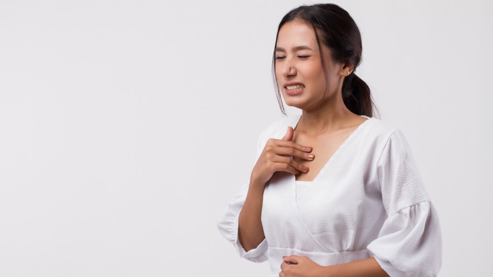 Woman with acid reflux