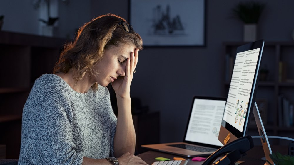 Woman staring at screen with a headache