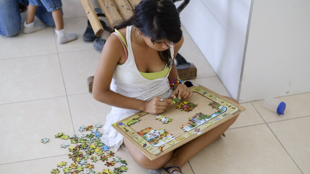 Girl doing jigsaw puzzle