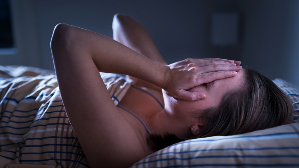 Woman waking up from a nightmare