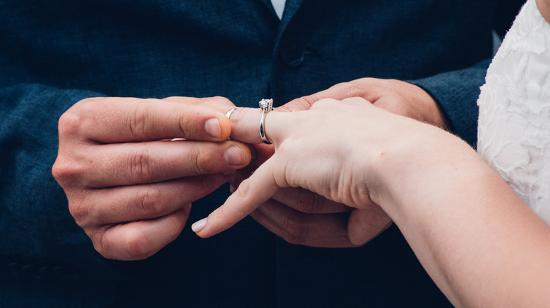 Wedding ring being placed on fourth finger