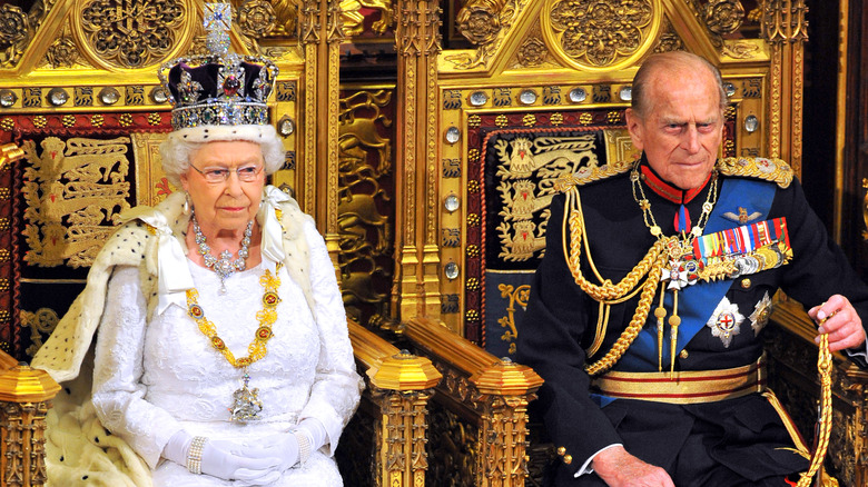 Queen Elizabeth and Prince Philip on their thrones