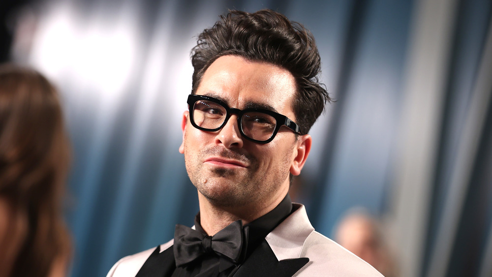 Dan Levy posing with a small smile