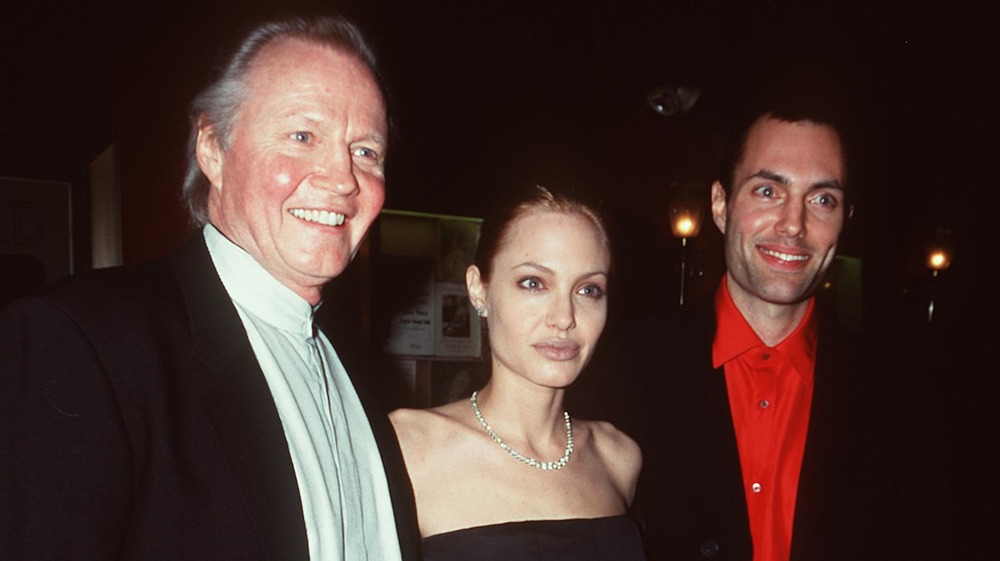 Angelina Jolie with her father and brother in 1999