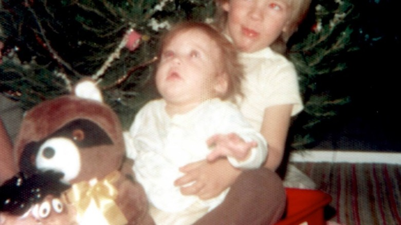 Jewel as a baby in a wagon with her brother