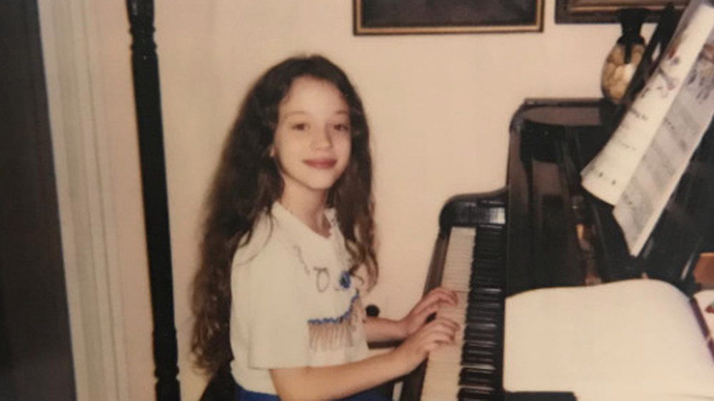 Kat Dennings as a child playing piano