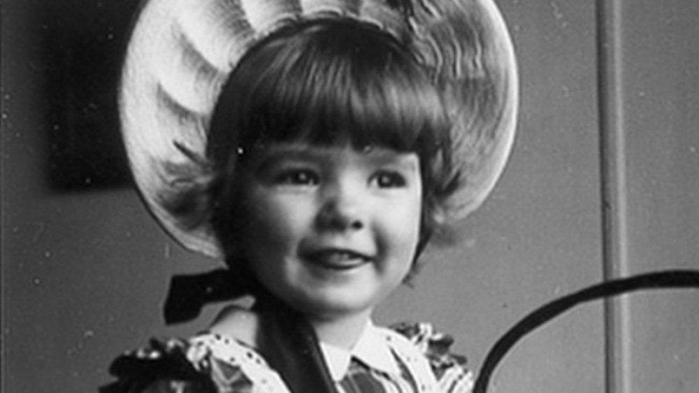 Martha Stewart as a young girl wearing a hat