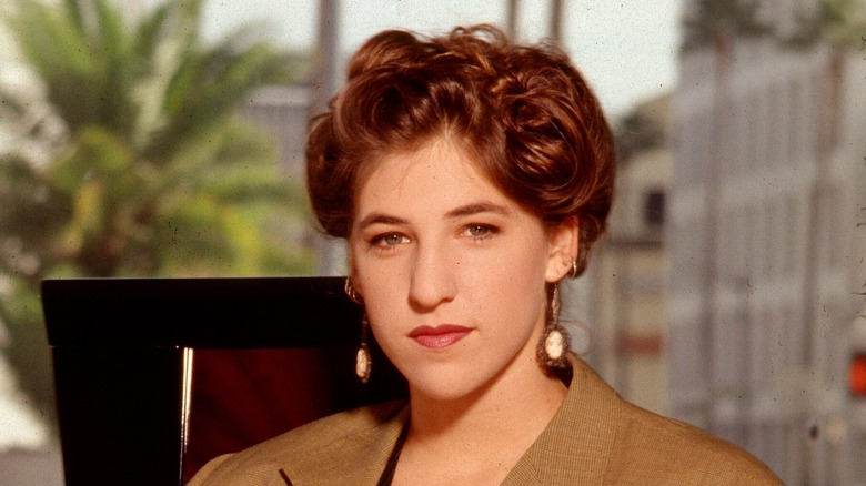 Mayim Bialik posing in an office chair