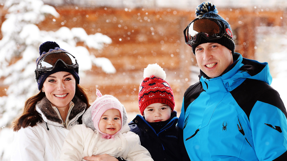 Kate Middleton, Prince William, and children smiling in ski gear