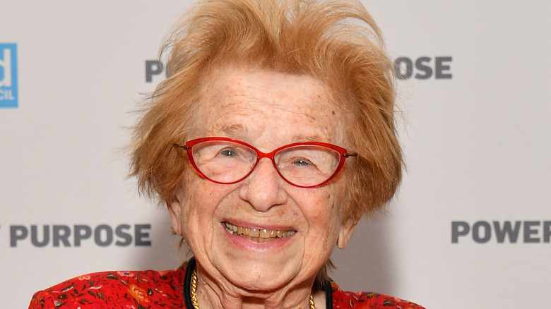 Dr. Ruth smiling with glasses