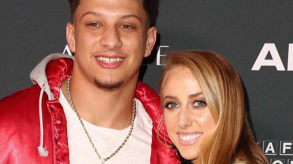 Patrick Mahomes and Brittany Matthews pose on red carpet