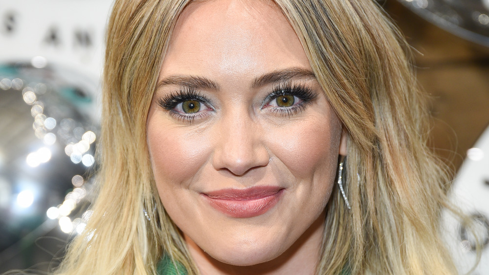 Hilary Duff wearing green with her hair down