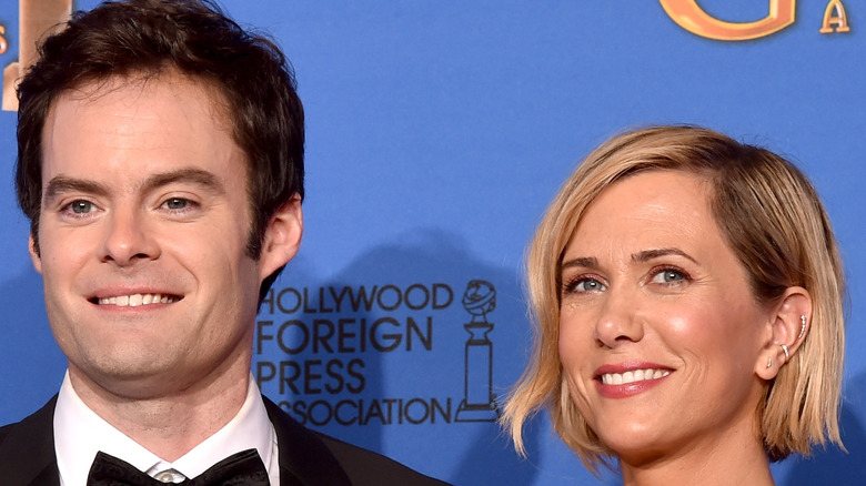 Actors Bill Hader and Kristen Wiig on red carpet