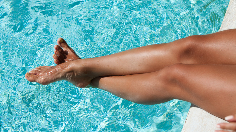 woman sitting by the pool