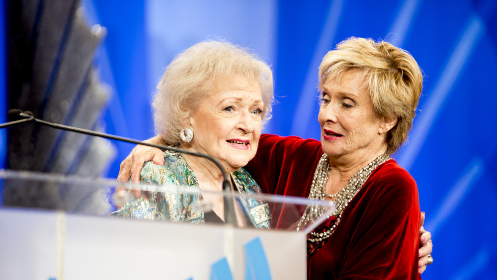 Cloris Leachman and Betty White hugging at an event