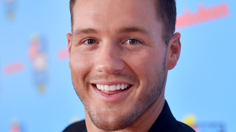 Colton Underwood smiles at an event