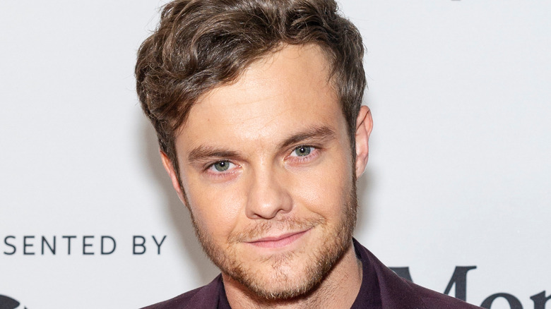 Jack Quaid smiling with head tilted