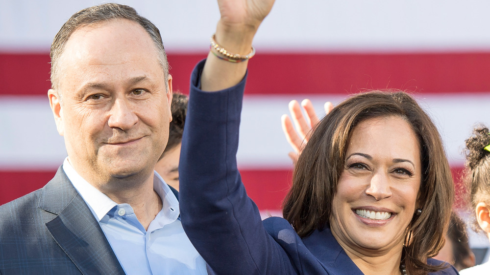 Kamala Harris and Doug Emhoff in front of a flag