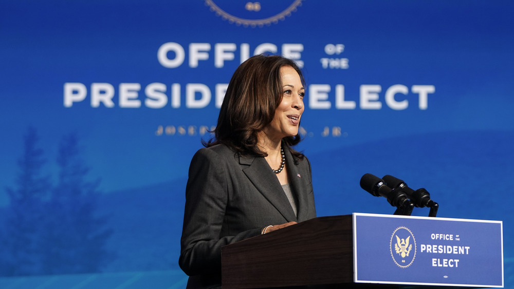 Kamala Harris speaks at a podium
