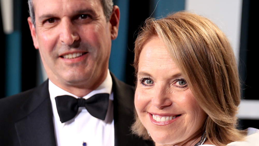 Katie Couric and John Molner close up and smiling