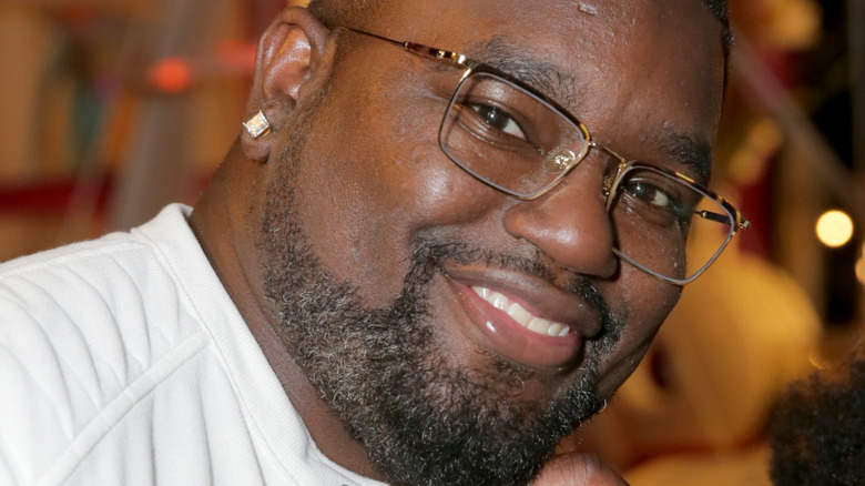 Lil Rel Howery head tilted in glasses