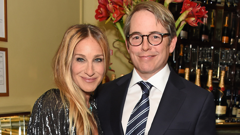 Sarah Jessica Parker and Matthew Broderick, smiling while posing arm in arm