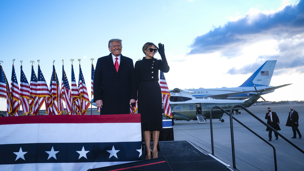 Melania Trump standing with husband