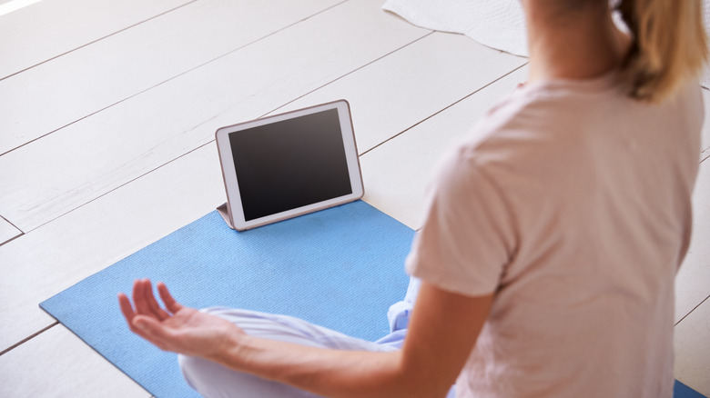 woman meditating with an app