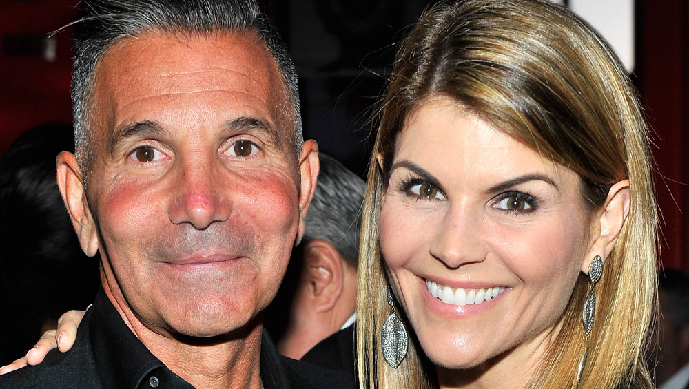 Mossimo Giannulli and Lori Loughlin smile together at event
