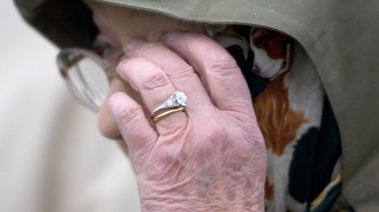 Close up of Queen Elizabeth's engagement ring and wedding band