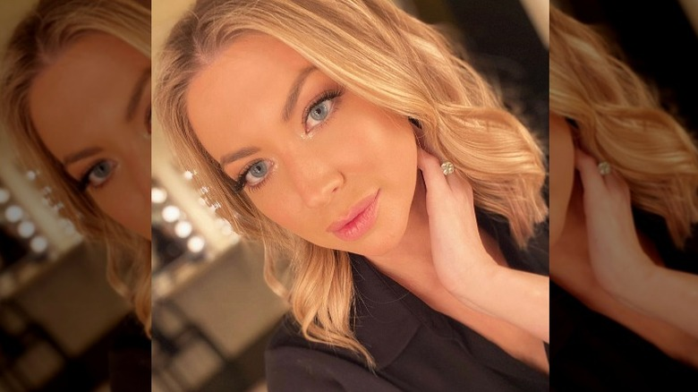 Stassi Schroeder showing off her engagement ring