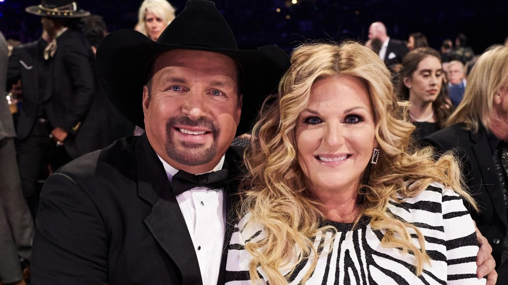 Garth Brooks and Trisha Yearwood attend the CMAs in 2019