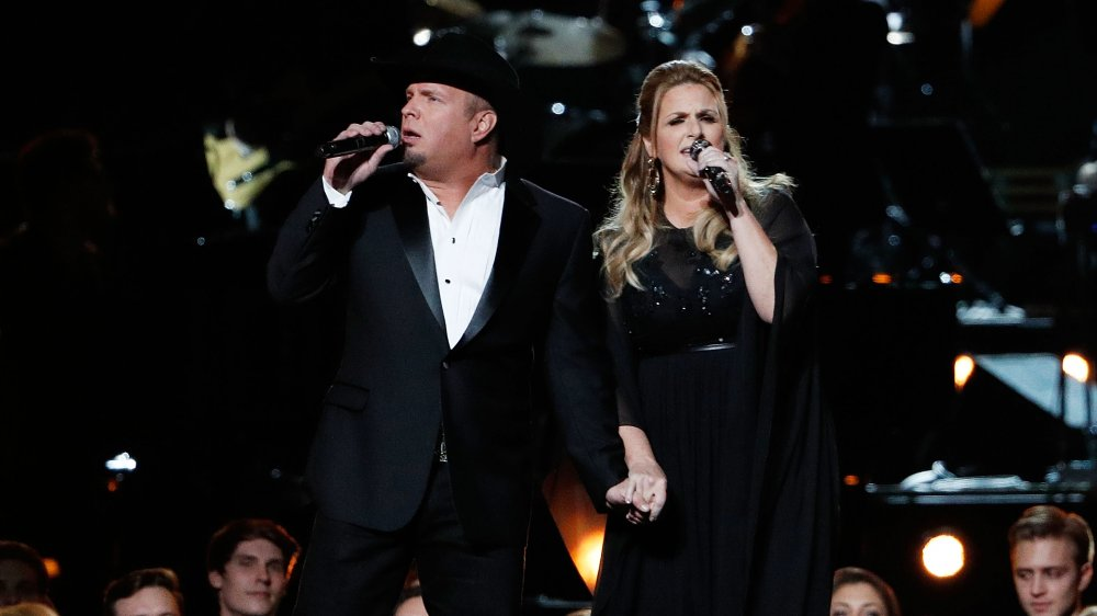 Garth Brooks and Trisha Yearwood perform onstage during the 50th annual CMA Awards in 2016