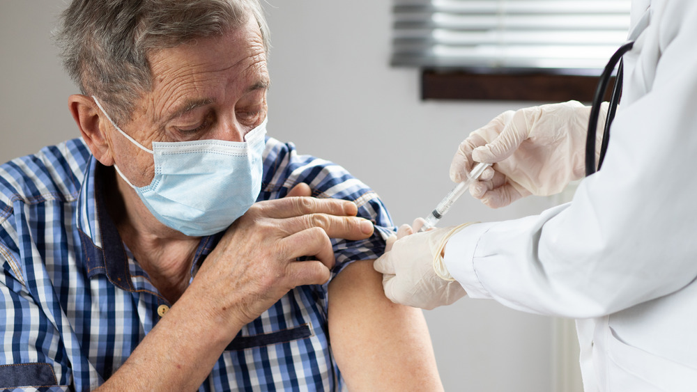 man getting COVID-19 vaccine