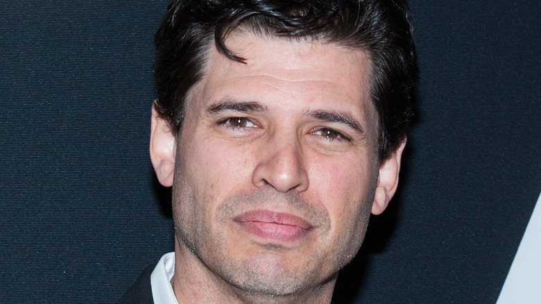 Max Brooks posing at event
