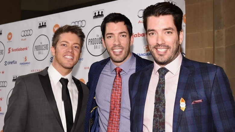 Property Brothers Jonathan Scott and Drew Scott with their brother J.D. Scott