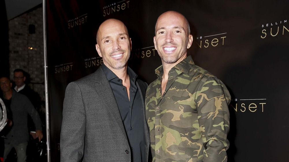 Jason and Brett Oppenheim smiling at an event