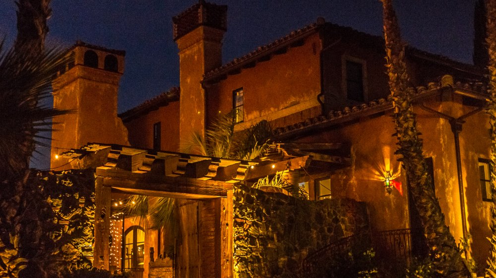 The exterior of Bachelor Mansion, with yellow lighting